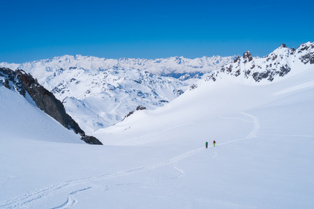 mountainscape: Ski alpinists skiing on the high mountans of Val Thorens, France