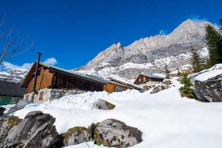 Winter landscape with chalet in Servoz, Chamonix, France