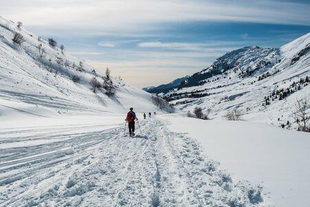 Trekker with snowshoes at Col de la Colombiere in Aravis mountains, Cluses, France