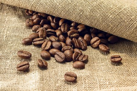 Coffee beans on light canvas photo