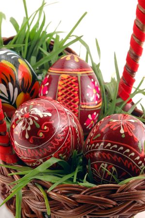 Close-up of Easter eggs in basket with grass photo