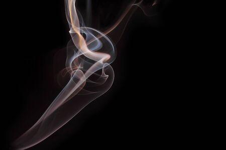 Blue and orange cigarette smoke on black background photo