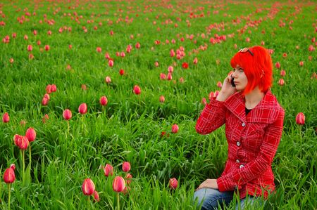 Young fashion girl calling on phone outdoors in green field Stock Photo - 2946332