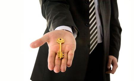 Businessman holding key isolated on white background Stock Photo - 2986645