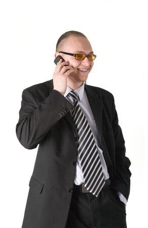 Smiling businessman calling on phone isolated on white background photo