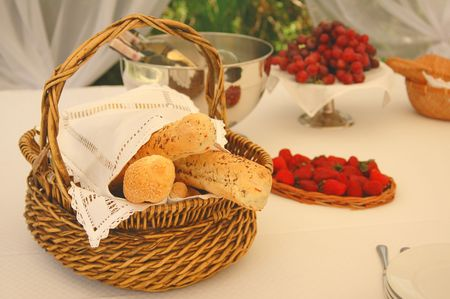 Table setting with bread basket and wine bottles on background Stock Photo - 3050671
