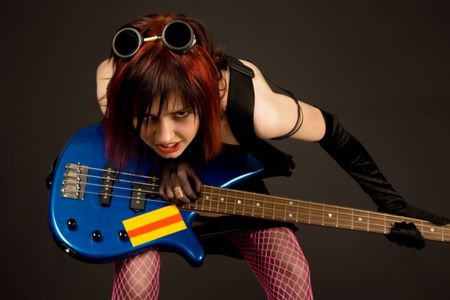 Sensual girl in crazy outfit with bass guitar photo