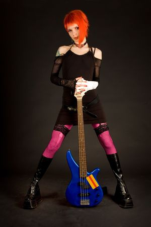 rock girl in crazy outfit holding bass guitar photo