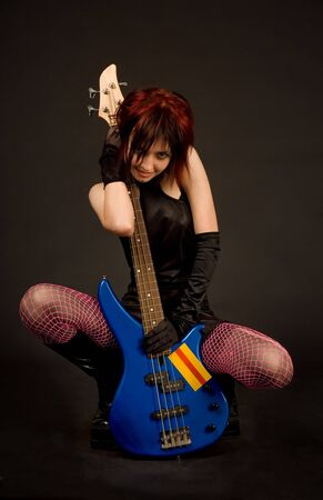 Beautiful rock girl with electric guitar photo