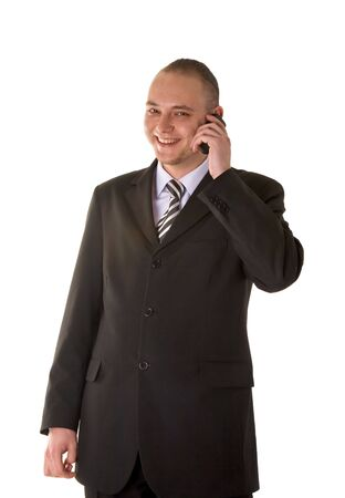 Laughing businessman calling on phone isolated on white background photo