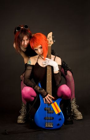 Rock girls with bass guitar isolated in studio Stock Photo - 3109671