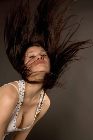 Beautiful girl shaking her head isolated in studio photo