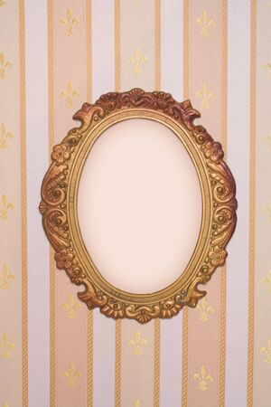 Oval frame with copy-space on vintage wallpaper photo