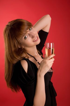 Smiling girl with champagne glass isolated on red background Stock Photo - 3363168