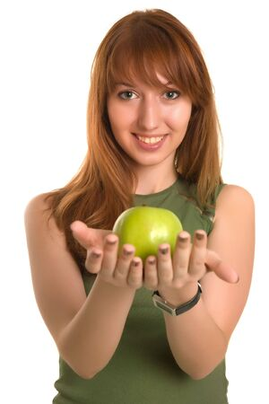 Young red-haired girl with green apple, focus on face photo