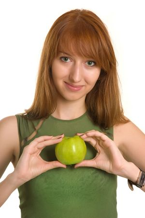 Sensual girl holding apple like a heart isolated on white background photo