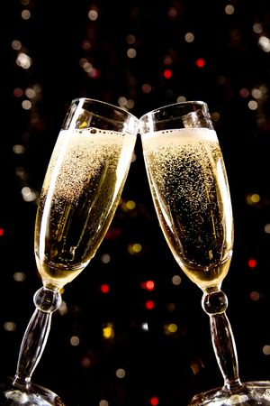gold flute: Two champagne glasses making toast over holiday background Stock Photo