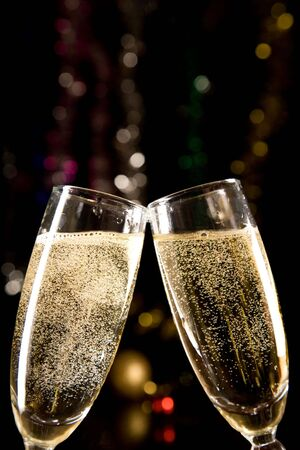 gold flute: Champagne glasses making toast over holiday background