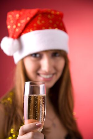 Mrs. Santa with champagne, focus on glass   photo