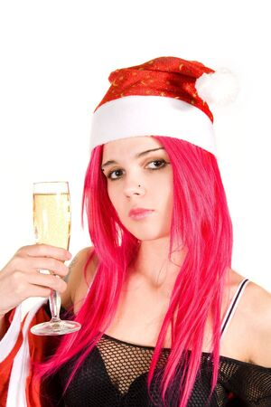 Portrait of a romantic Mrs. Santa with champagne glass, isolated on white background photo