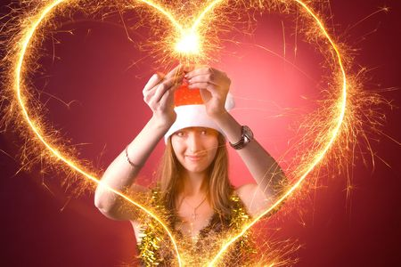 Attractive girl drawing burning heart  photo