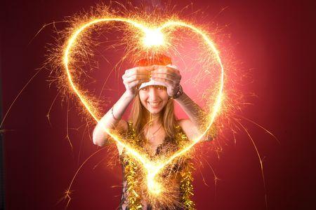 Smiling girl drawing burning heart  Stock Photo - 3976956