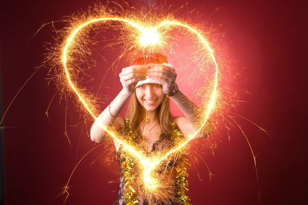 Smiling girl drawing burning heart Stock Photo - 3976956