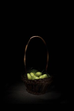 Easter basket with eggs, effect of glowing in darkness  photo