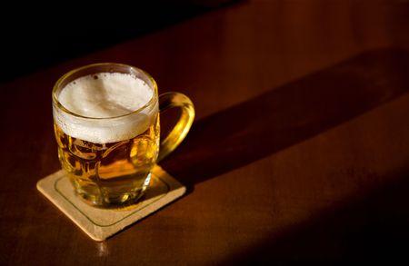 Beer mug over wood background Stock Photo - 4715970