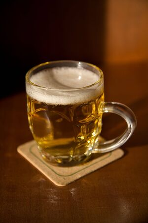 Beer mug on a coaster with blank space for your label   Stock Photo - 4753053