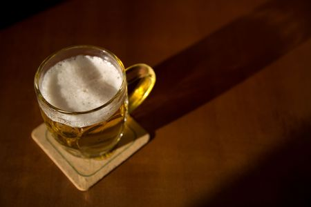 Beer mug on a coaster, selective focus Stock Photo - 4753055