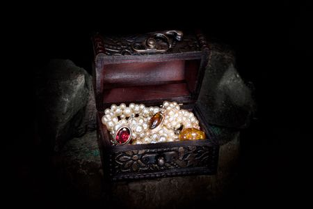 valuables: Treasure chest in a dark cave  Stock Photo