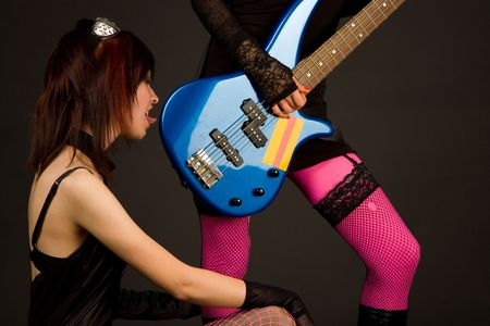 Two girls with bass guitar, studio shot  photo