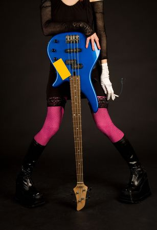 Close-up of girl with bass guitar and cigarette, studio shot   photo
