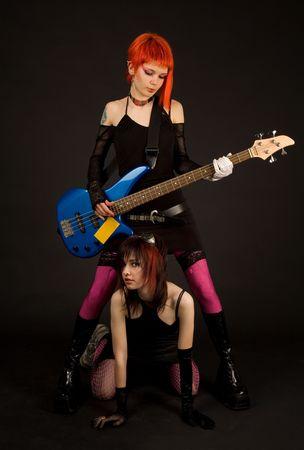 Two rock girls with guitar, studio shot Stock Photo - 4794519