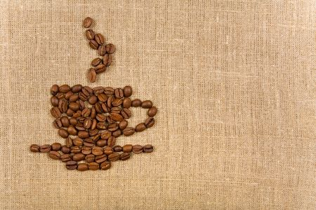 Coffee cup made of beans over canvas background, lot of copy-space  photo