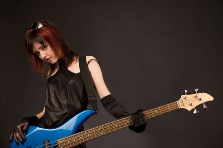 rockstar: Sexy girl in crazy outfit with bass guitar, studio shot  Stock Photo