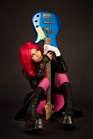 Romantic girl with guitar, studio shot  photo