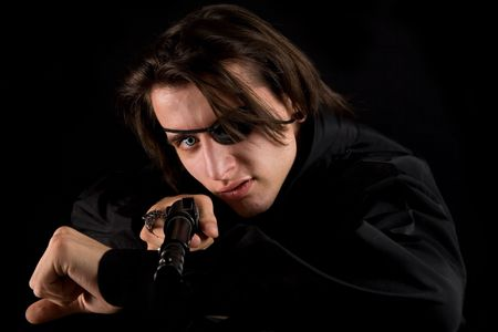 Handsome pirate with gun, isolated on black background, Halloween theme  Stock Photo - 5488209