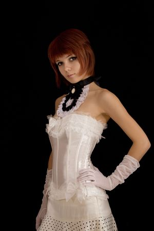 lace gloves: Attractive girl in white bridal corset, isolated on black background
