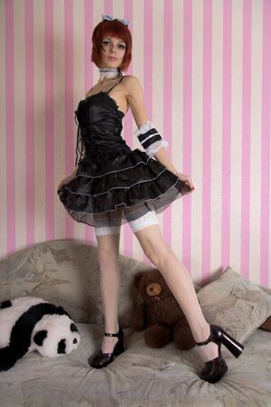 lolita: Japanese style Gothic Lolita girl with toys in funny interior  Stock Photo