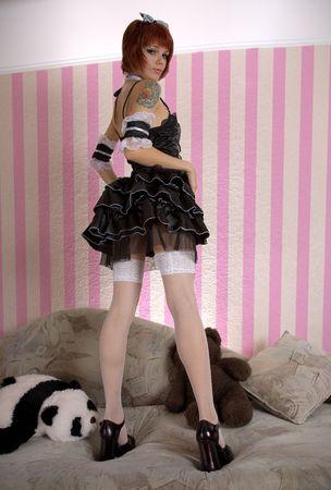 lolita: Attractive girl dressed like Gothic Lolita in funny interior  Stock Photo