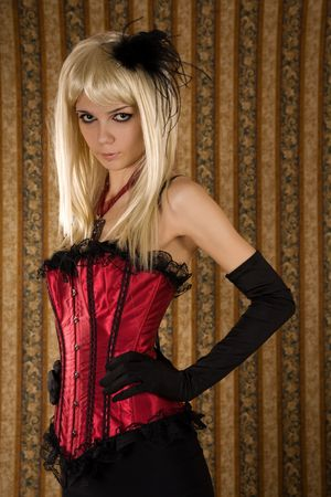 red corset: Expressive girl in red corset, glamour background