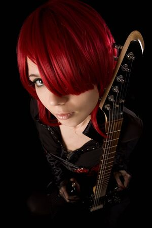 Rock girl with guitar, selective focus, high angle view  photo