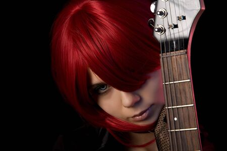 Vampire girl with guitar, focus on face  photo