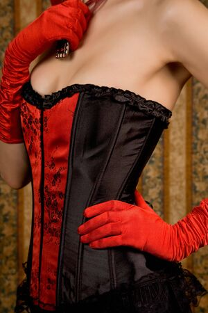 red corset: Close-up of slim woman in red corset, glamour background