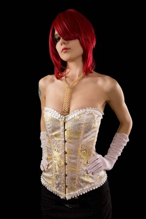 Young attractive woman in glamour corset, isolated on black background    photo