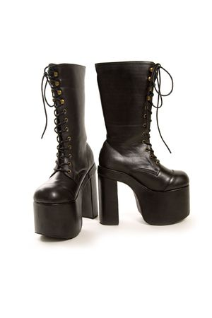 subculture: Gothic boots, studio shot isolated on white background