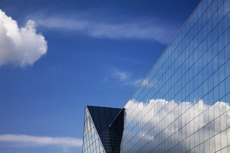 Modern building and blue sky with cloudscape reflection  photo
