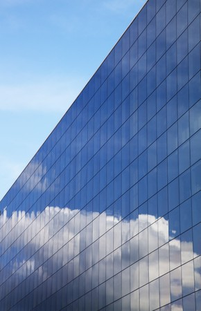 Modern office building and blue clear sky reflection  photo